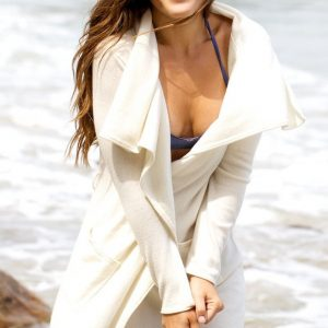 Model Shannon Decker wearing the Cashmere Lesley Robe ivory champagne colored at the beach by Anna Kouture
