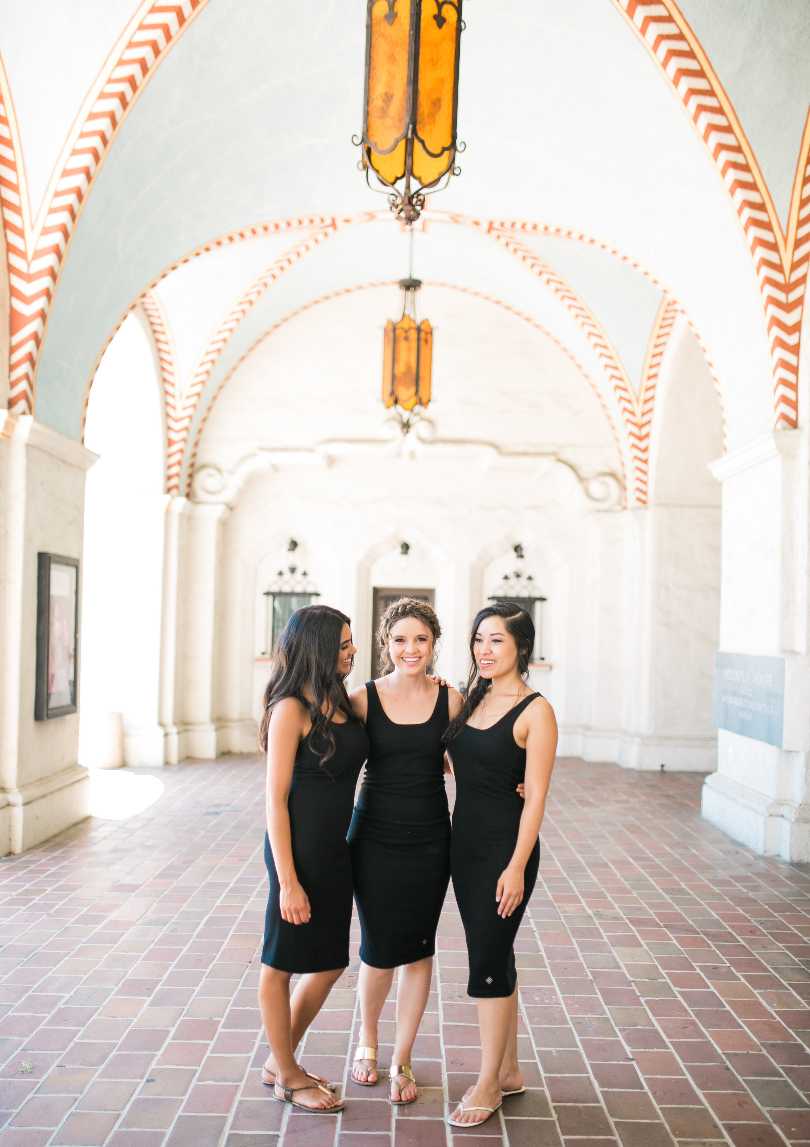 The three models are wearing the black Gianna skinny dress.